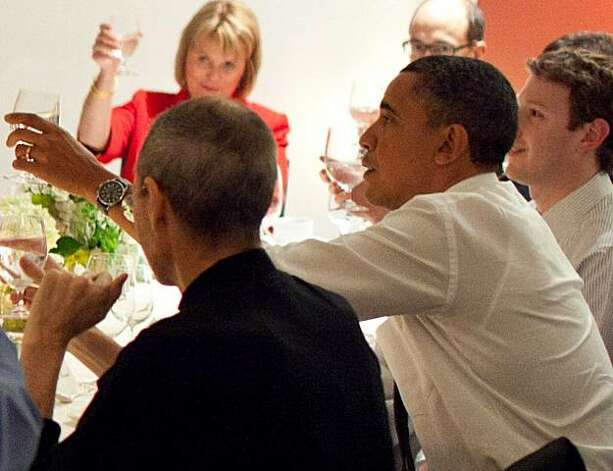 President Barack Obama (center)  joins a toast with Technology Business Leaders including Steve Jobs (left) and Mark Zuckerberg (right) at a dinner in Woodside, California on Thursday, Feb. 17, 2011. Photo: Pete Souza, The White House