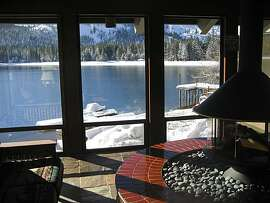 Donner Lake Village Resort: The lakeside lounge, a gathering area for visitors to Donner Lake Village Resort, provides a view of Donner Lake and a gas fireplace.