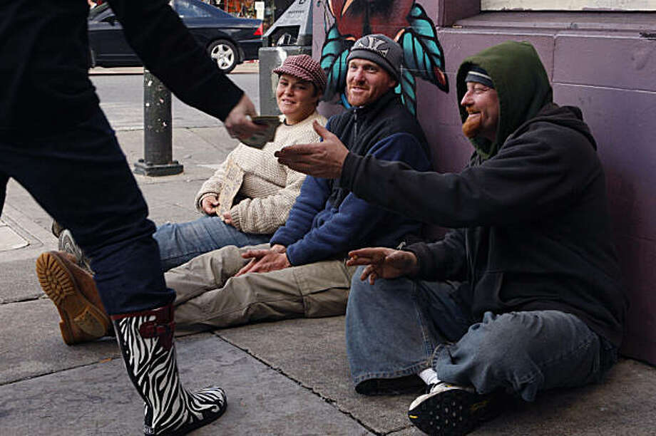 A woman gives money to Clint of Louisiana and his friends Betty and Brock (left to right) on Haight Street in San Francisco Calif, on Wednesday, Feb. 16, 2011. The woman gave money to Clint after he told her directions to a store her and her companions were looking for. Photo: Alex Washburn, The Chronicle