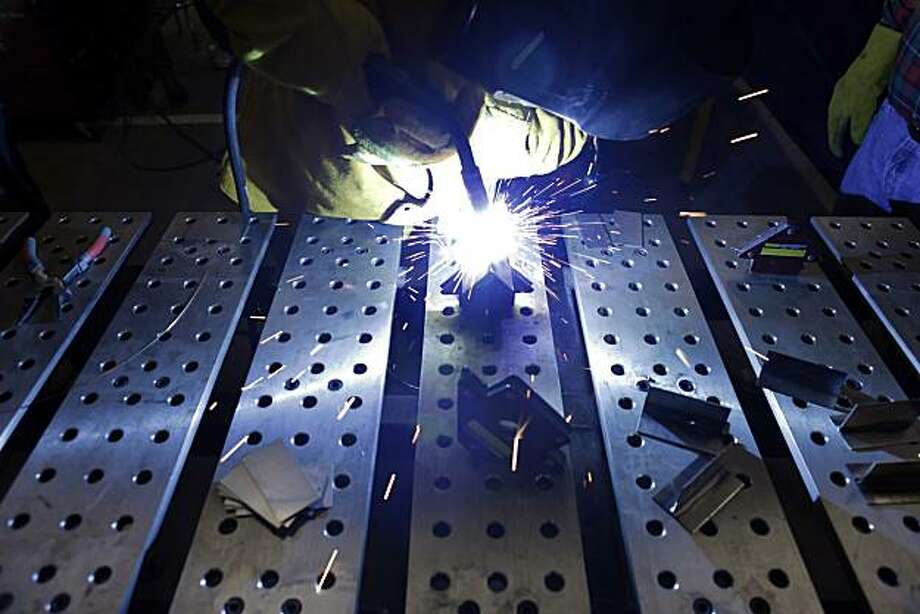 Andrew Hash practices his welds during a class run by Rebecca Chapman at the TechShop in San Francisco, Calif., on Monday, February 7, 2011. The TechShop is a cross between High School shop class and high tech factory. Membership in the workshop allows access to light and heavy machinery and tools. Members, range from hobbyists to entrepreneurs, creating everything from t-shirts to light fixtures, to prototypes to motorcycles. Photo: Carlos Avila Gonzalez, The Chronicle