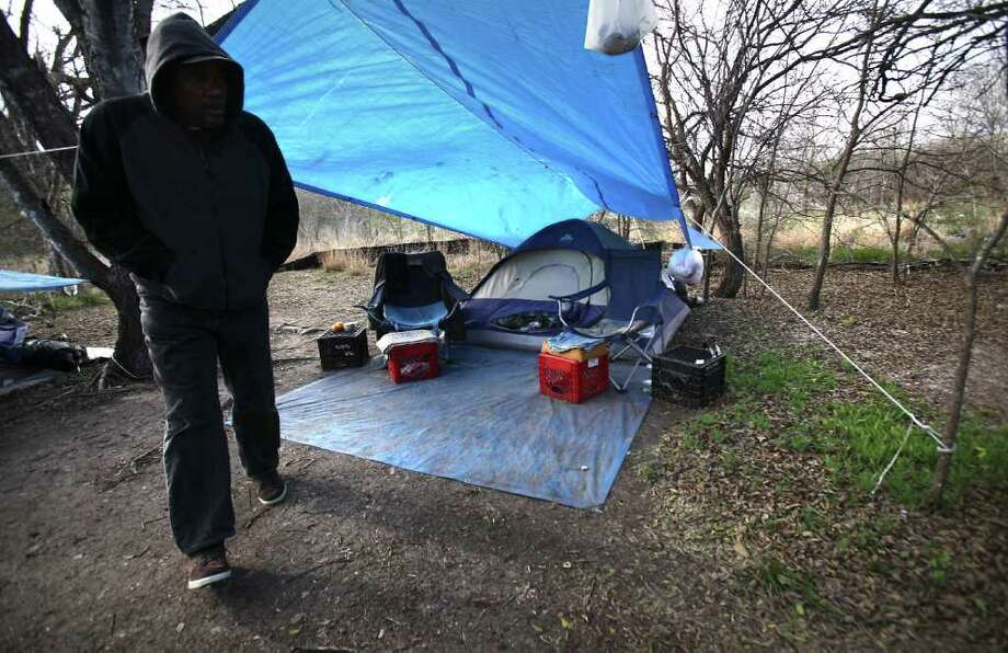 Ron Brown, Prospect Courtyard Liaison at Haven for Hope, visits homeless camps near Goliad Rd. and SE Military Dr., encouraging them to visit the shelter, Thursday, Jan. 12, 2012. Photo: BOB OWEN, SAN ANTONIO EXPRESS-NEWS / rowen@express-news.net