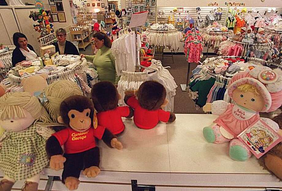 Shoppers check out the clothing section of Lullaby Lane, a family run children's store in San Bruno. Photo: Michael Maloney