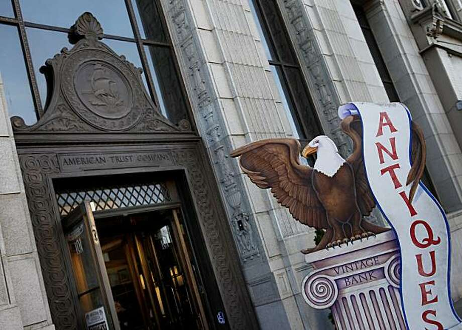 Detail from the front of a downtown antique store which occupies a former bank. In Petaluma, Calif., comparing old building exteriors and modern day tenants Thursday February 10, 2011. Photo: Brant Ward, The Chronicle