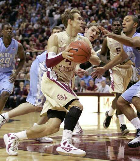 Florida State's Deividas Dulkys tries to get past the defense of North Carolina's Kendall Marshall, right and Tyler Zeller, center, during the first half of an NCAA college basketball game, Saturday, Jan. 14, 2012 in Tallahassee, Fla. Photo: AP