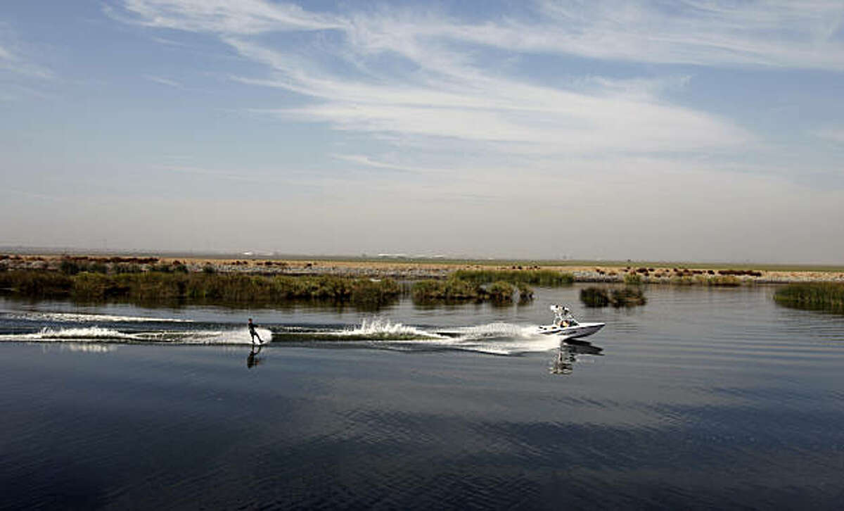 A wake boarder skis on Victoria Canal in the California Delta on Friday October 17, 2008 in Byron, Calif.