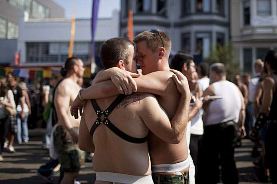 Stephen Yardbrough (right) of San Francisco embraces a friend at the annual Folsom Street Fair in San Francisco on Sunday. Photo: Stephen Lam, The Chronicle