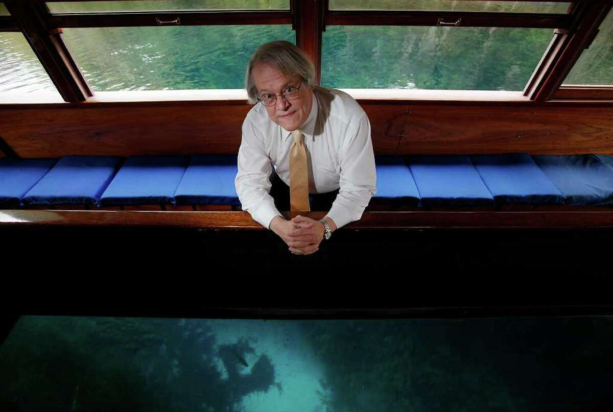 Robert Gulley poses for a portrait in a glass-bottomed boat at Aquarena Springs in San Marcos on Friday, Nov. 18, 2011. Gulley is the director of the Edwards Aquifer Recovery Implementation Program. Gulley was honored at a reception for his efforts in creating a plan to balance the demands of water needs on the Edwards Aquifer. Kin Man Hui/kmhui@express-news.net