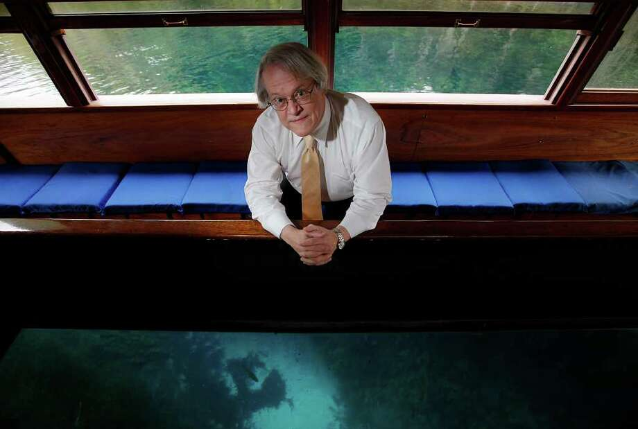 Robert Gulley poses for a portrait in a glass-bottomed boat at Aquarena Springs in San Marcos on Friday, Nov. 18, 2011. Gulley is the director of the Edwards Aquifer Recovery Implementation Program. Gulley was honored at a reception for his efforts in creating a plan to balance the demands of water needs on the Edwards Aquifer. Kin Man Hui/kmhui@express-news.net Photo: KIN MAN HUI, SAN ANTONIO EXPRESS-NEWS / SAN ANTONIO EXPRESS-NEWS