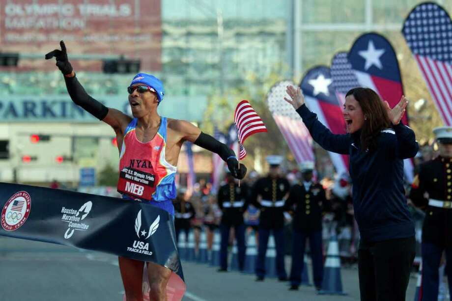 Meb Keflezighi crosses the finish line to win the U.S. Olympic Trials Marathon. Photo: Smiley N. Pool, Houston Chronicle / © 2012  Houston Chronicle