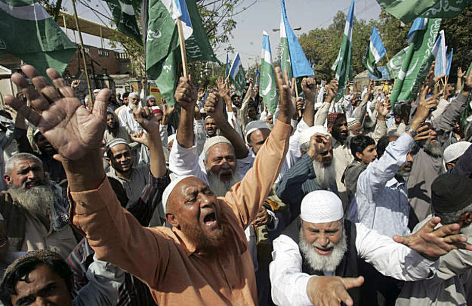 Supporters of Pakistani religious party Jamat-e-Islami shout slogans during a rally against Raymond Allen Davis, a U.S. consulate employee suspected in a shooting, in Karachi, Pakistan, Friday, Feb. 11, 2011. A Pakistani judge on Friday ordered that an American, detained in the shooting deaths of two Pakistanis, remain in custody for 14 more days and also told the government it must clarify whether the man has diplomatic immunity as Washington claims. Photo: Fareed Khan, AP