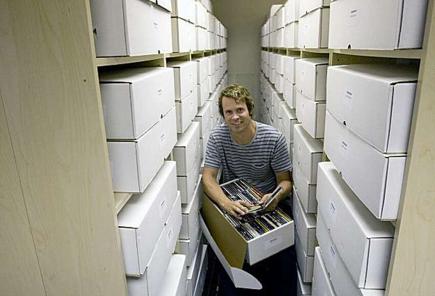 Tim Westergren, the founder of the internet radio company Pandora, sits among boxes filled with CDs that make up Pandora's Music Genome Project at their offices in Oakland, Calif., on Wednesday, July 29, 2009.