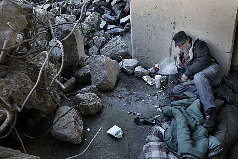 Michael, a homeless man who used to live in the shadow of the Transbay Terminal, now sleeps near the rubble created by the demolition Wednesday February 9, 2011. It has been six months since San Francisco, Calif., city officials cleared out a large congregation of homeless people from the Transbay Terminal at First and Mission Streets. Photo: Brant Ward, The Chronicle