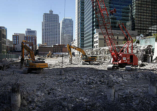 Demolition equipment sits in the crater of what used to be the Transbay terminal. It has been six months since San Francisco, Calif., city officials cleared out a large congregation of homeless people from the Transbay Terminal at First and Mission Streets. Photo: Brant Ward, The Chronicle