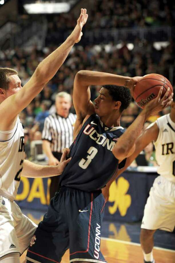 Connecticut guard Jeremy Lamb, is defended by Notre Dame guard Pat Connaughton in an NCAA college basketball game Jan.14, 2012 in South Bend, Ind.  . (AP Photo/Joe Raymond) Photo: Joe Raymond/Associated Press / Joe R. Raymond
