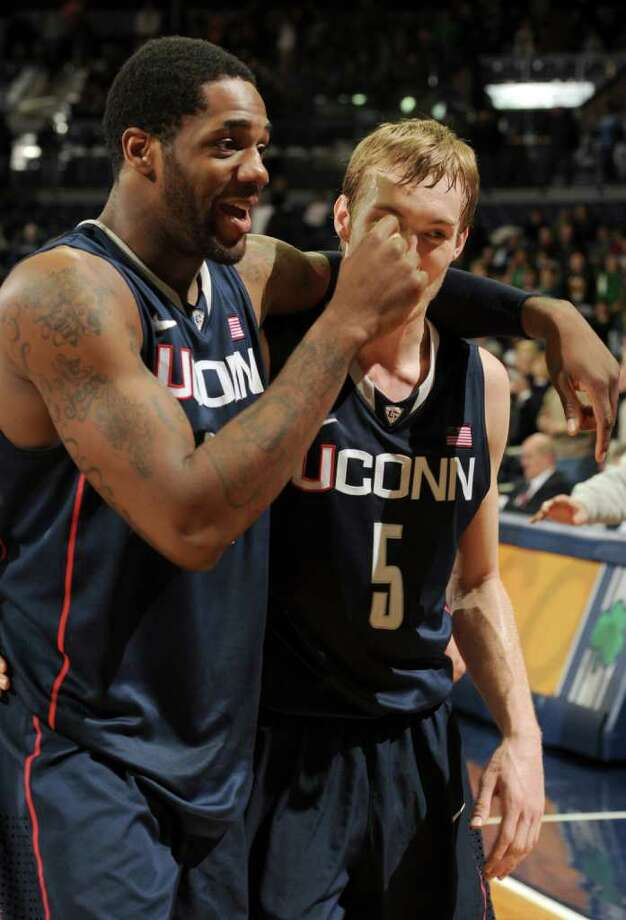 Connecticut forward Alex Oriakhi, left and guard Niels Giffey celebrate their 67-53 victory over Notre Dame in an NCAA college basketball game, Saturday, Jan. 14, 2012, in South Bend, Ind. (AP Photo/Joe Raymond) Photo: JOE RAYMOND, Joe Raymond/Associated Press / Joe R. Raymond