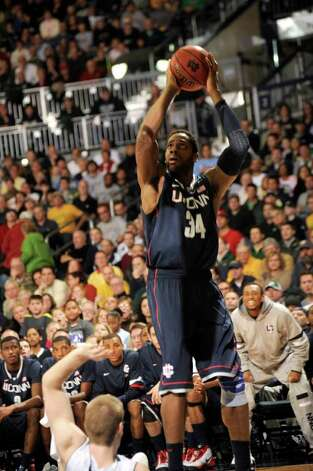 Connecticut forward Alex Oriakhi puts up a shot in an NCAA college basketball game Jan.14, 2012 in South Bend, Ind. (AP Photo/Joe Raymond) Photo: Joe Raymond/Associated Press / Joe R. Raymond