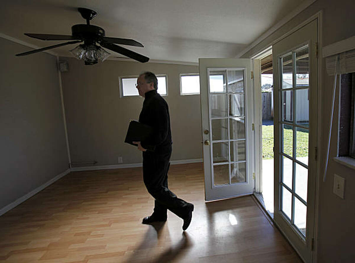 Douglas MacDonald of Coldwell Banker Solano Pacific walks through a room leading to the backyard of the Georgia Street home. The continuing decline in Bay Area home values is illustrated by a pleasant three bedroom home in Vallejo, Calif., which sold in 2005 for over $400,000 and is now on the market for $125,000 Tuesday February 8, 2011.