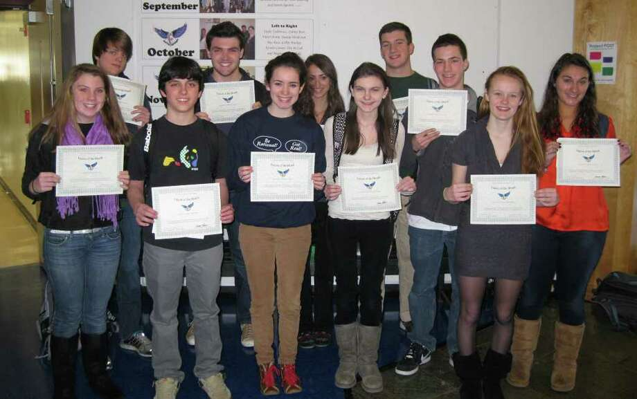 Fairfield Ludlowe High School students who were  observed honoring obligations to themselves and their friends were nominated for the Falcon of the Month Award for December.  ìCommitmentî was the trait from Ludlowe's mission statement highlighted that month.  Housemasters and the Headmaster awarded certificates.  From left are Olivia Anderson, Will Powers, Evan MacGuffie, Steve Autore, Danielle Cupp, Casey Clifford, Colleen Granberg, Mike Poudrier, Ethan Freedman, Kate Lamontagne and Maggie Lapolla.  Jessica Gallo also was honored but is not pictured. Photo: Contributed Photo