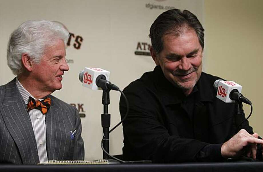San Francisco Giants managing general partner Bill Neukom (left) announces that the team has exercised its options on manager Bruce Bochy (right) and general manager Brian Sabean's contracts at AT&T Park in San Francisco, Calif., on Friday, Feb. 4, 2011. Photo: Paul Chinn, The Chronicle
