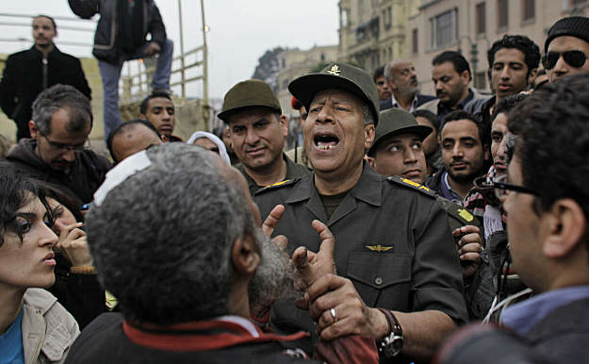 Egyptian Army Gen. Hassan El-Rueini tours the anti-government protest site to calm the fears of demonstrators there, following a tense standoff between the army and protesters, in Tahrir square in Cairo, Egypt, Saturday, Feb. 5, 2011. Egyptian State TV says the top leadership body of Egypt's ruling party, including the president's son Gamal Mubarak and the party secretary-general Safwat el-Sharif, resigned Saturday.