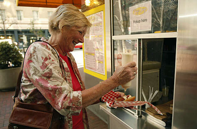 Elizabeth Herbert laughs as mayonnaise splatters across her hotdog at Zog's Dogs in San Francisco Calif. on Wednesday, Feb. 2, 2011. Zog's Dogs is so small it only has three employees. Photo: Alex Washburn, The Chronicle