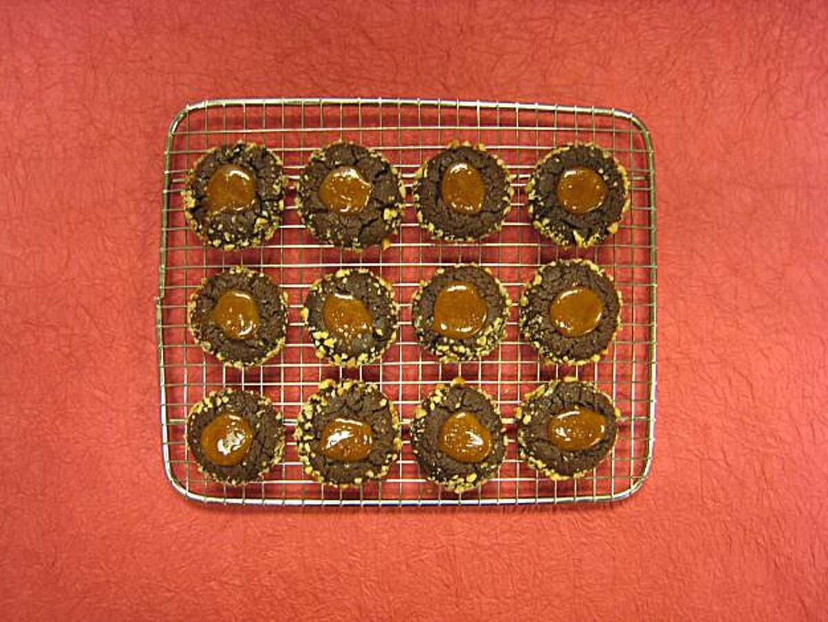 Chocolate-Caramel Cookies. These cookies - crisp on the outside and fudgy on the inside - are topped with caramel.