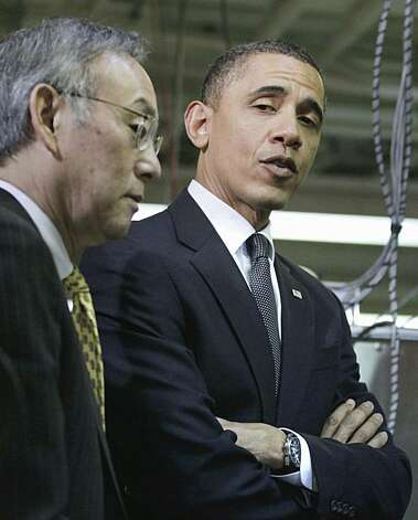 President Barack Obama looks to Energy Secretary Steven Chu, right, as they tour a lab on the Penn State University campus in State College, Pa., Thursday, Feb. 3, 2011. Photo: Carolyn Kaster, AP