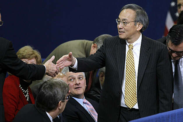 Energy Secretary Steven Chu meets with people in an audience before President Barack Obama spoke at Penn State University in State College, Pa., Thursday, Feb. 3, 2011. Obama called on Congress to provide companies with a tax credit to reward them for retrofitting their buildings in a way that decreases energy use. He's also calling for broader access to financing for businesses that want to make energy-saving upgrades. Photo: Matt Rourke, AP
