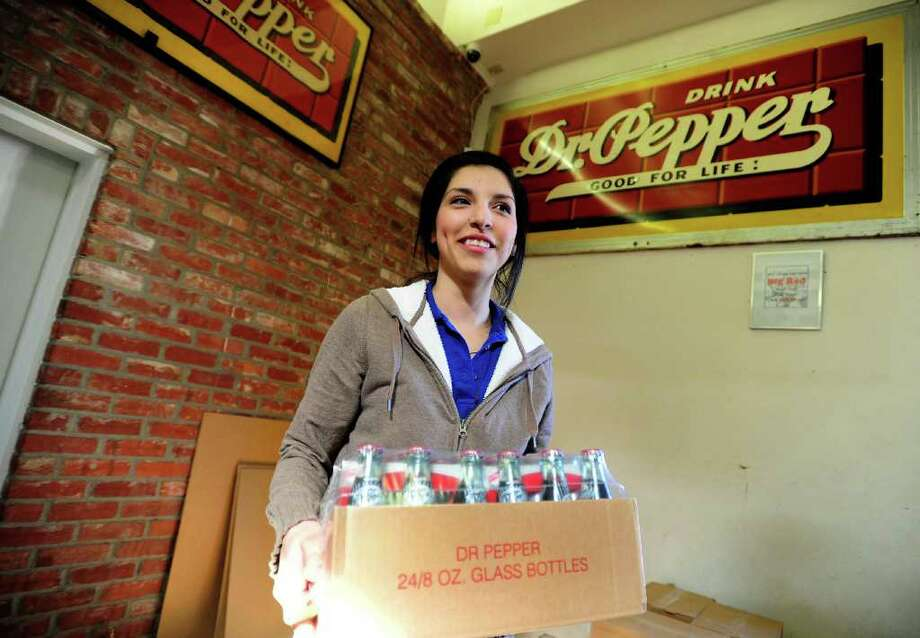 Annabell Sanchez, an Old Doc's Soda Shop employee, holds the last case of Dublin Dr Pepper ever to be to sold from the store on Thursday, Jan. 12, 2012 in Abilene, Texas. Photo: AP