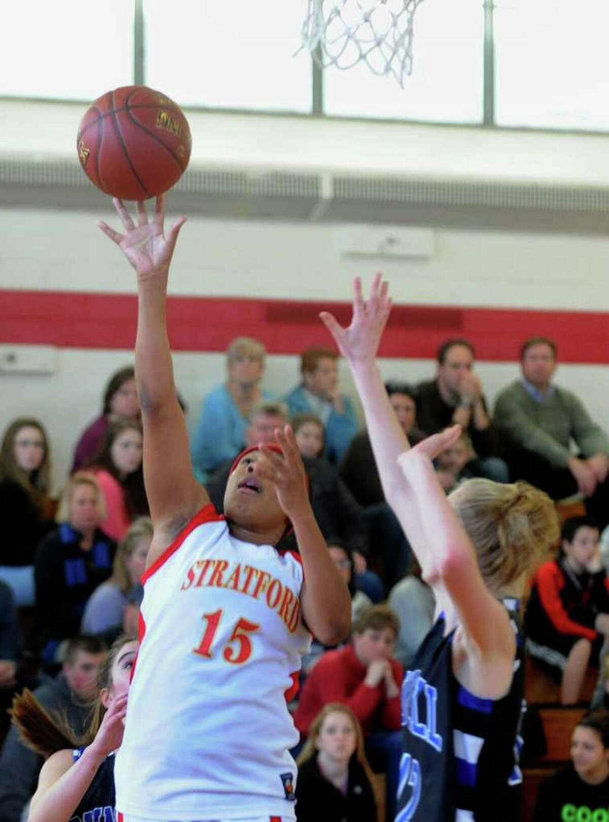 Stratford's #15 Teanna Gordon releases a shot, during girls basketball action against Bunnell in Stratford, Conn. on Saturday January 14, 2012.
