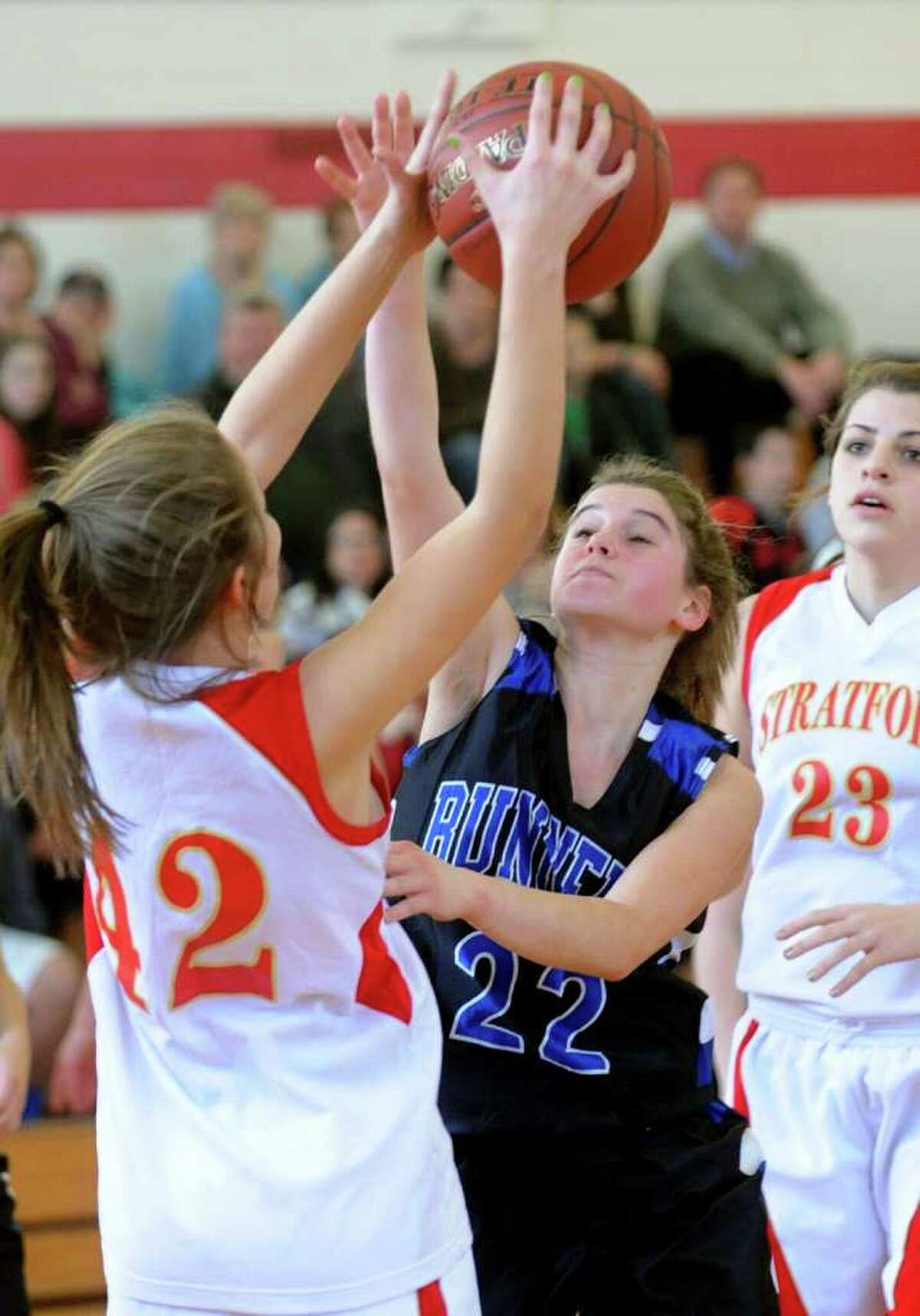 Bunnell's #22 Jessica Bogdwicz blocks a pass attempt by a Stratford player, during girls basketball action in Stratford, Conn. on Saturday January 14, 2012.