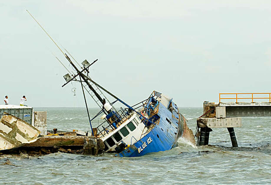 A shipwrecked boat hit by Hurricane Jimena, in Puerto San Carlos, Baja California state, Mexico, on September 2, 2009. Jimena crashed Wednesday into Mexico's Baja California, forcing thousands to seek emergency shelter as it buffeted islands off the coast with high winds and heavy rain. AFP PHOTO/Ronaldo SCHEMIDT (Photo credit should read Ronaldo Schemidt/AFP/Getty Images) Photo: Ronaldo Schemidt, AFP/Getty Images