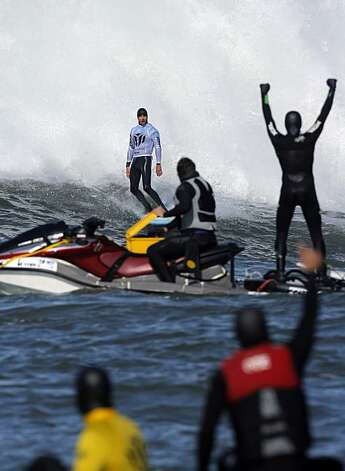 "Support crews react to Grant ""Twiggy"" Baker's ride in the fifth heat. Surfers from around the globe braved the 50-foot-high swells at Mavericks Surf Contest in Half Moon Bay, Calif., on Saturday, February 13, 2010. Chris Bertish of South Africa was selected the winner. Photo: Carlos Avila Gonzalez, The Chronicle"
