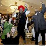 Ruth Dewson, in red hat, and Darryl Kelly led the cheer as Obama spoke on a giant TV. A large crowd gathered at the Fairmont Hotel in San Francisco to celebrate Barack Obama's victories Tuesday night.