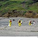 Beaches in Pacifica are closed because of tar that is washing up..People working with the Coast Guard walked Lindamar beach  picking up the tar.