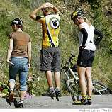 Members of the Roaring Mouse Cycling Clug of San Francisco stand by a make shift memorial has was placed at the scene March 10, 2008, of where Deputy James Council who was working patrol Sunday morning crossed onto the wrong side of Stevens Canyon Road at 10:25 a.m. and rammed the three southbound bicyclists head-on killing two and injuring the other.