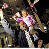 Leonard Golson from San Francisco Calif and his three year old daughter Anjaleeah celebrate Barack OBama victory Tuesday November 4, 2008 at the corners of Fillmore and Eddy streets in San Francisco.