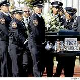 Members of the Fairfield fire department carried Garcia's coffin onto the football field for the memorial. Several thousand gathered at Armijo High School in Fairfield for a memorial to slain Fairfield councilman Matt Garcia Tuesday, September 9, 2008.