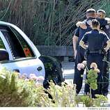 Two Martinez police officers console each other outside the Connolly and Taylor Funeral Home where Sgt. Paul Starzyk body was taken from the coroners office to the mortuary, in Martinez, Calif., on September 8, 2008.Ran on: 09-09-2008Silvia Torres Limon (center left), with brother Eustacio Torres and sister Patricia Bustamante, confronted Martinez police at a news conference.Ran on: 09-09-2008Silvia Torres Limon (center left), with brother Eustacio Torres and sister Patricia Bustamante, expresses outrage at Martinez authorities.