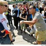 Anti-abortionist Eric West, left,  fight with Joe outside the perimeter of the Pepsi Center where people enter to attend the Democratic National Convention, Tuesday,  Aug. 26, 2008 in Denver, Colorado.