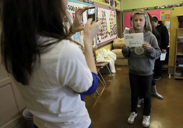 Social worker Meghan Graber film the students in the Gay Straight Alliance ...