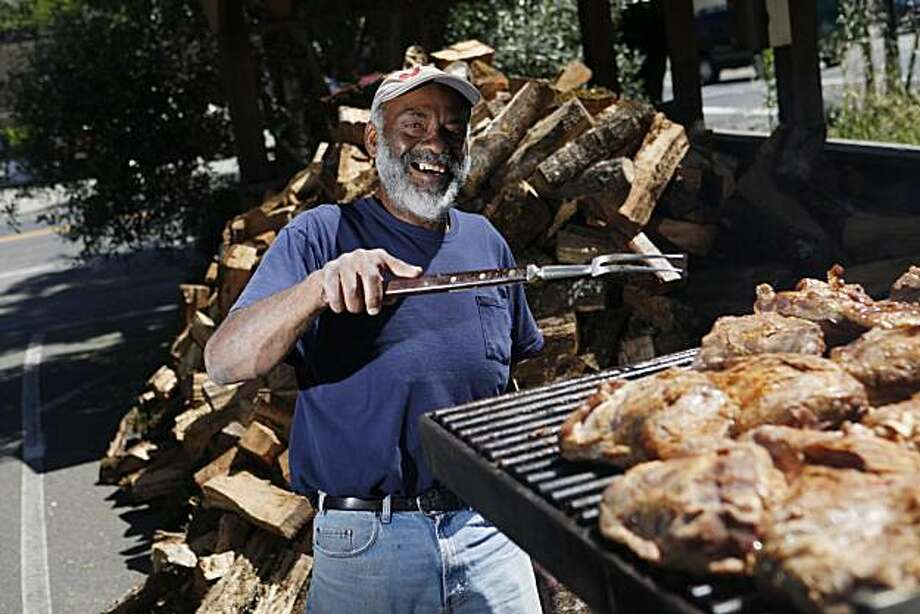 Buster Davis, owner of Buster's Southern BarBeQue and bakery, smiles as he tends to the grill on Tuesday June 15, 2010 in Calistoga, Calif. Photo: Mike Kepka, The Chronicle