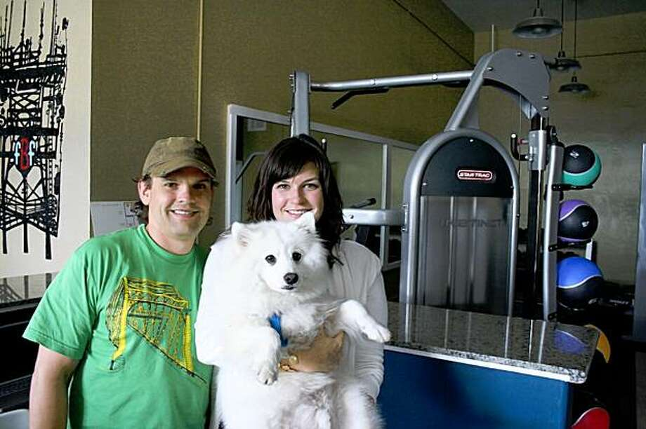 Dean and Jeanne Eriksen, with Coyote, in their soon-to-open gym, Fit Bernal Fit. Photo: Chris Colin
