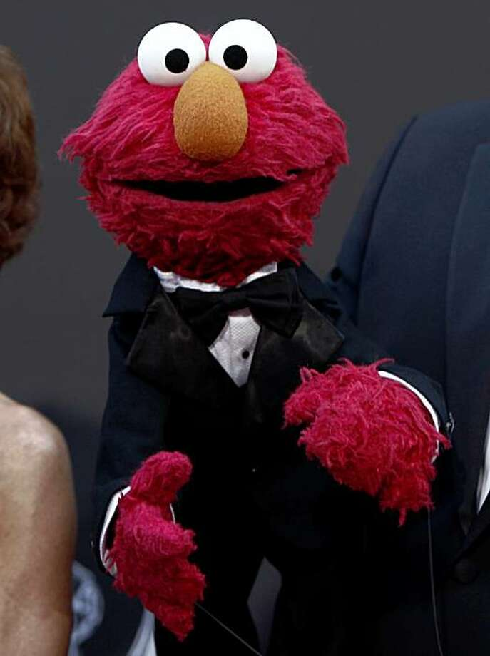 Sesame Street's Elmo arrives at the Daytime Emmy Awards on Sunday Aug. 30, 2009, in Los Angeles. Photo: Matt Sayles, AP