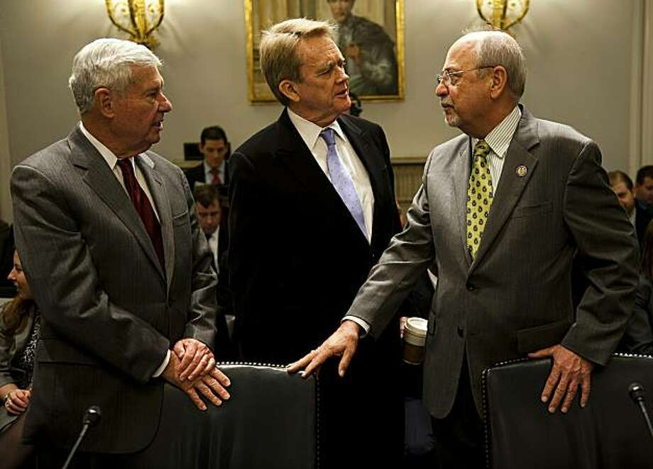 """Chairman of the House Natural Resources Committee Doc Hastings, R-WA, speaks with former EPA Administrator William Reilly (C) and former US Senator Bob Graham (L) as they prepare to testify before the House Natural Resources Committee on """"Final Report from the President's National Commission on the BP Deepwater Horizon Oil Spill and Offshore Drilling"""" on Capitol Hill in Washington, DC, January 26, 2011. Photo: Jim Watson, AFP/Getty Images"""