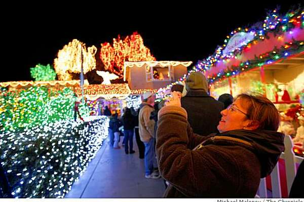 Paula Hunt of Pleasant Hill, Calif., takes a photo of a few of the 301,000 Christmas lights on display in the yard of Livermore, Calif. resident Dave Rezendes on Saturday, December 20, 2008.