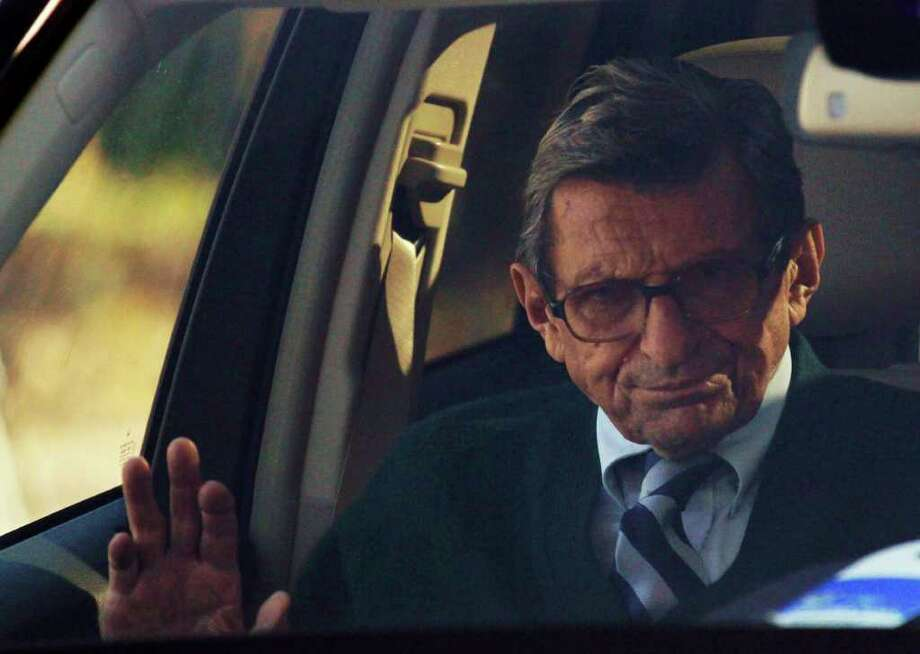 In this Nov. 9, 2011 file photo, Penn State football coach Joe Paterno arrives home in State College, Pa. The ouster of one of America's most revered coaches, Penn State's Joe Paterno, after shocking child sex abuse charges against his former assistant was overwhelmingly voted the sports story of the year by members of The Associated Press.  (AP Photo/Matt Rourke, File) Photo: Matt Rourke / 2011 AP