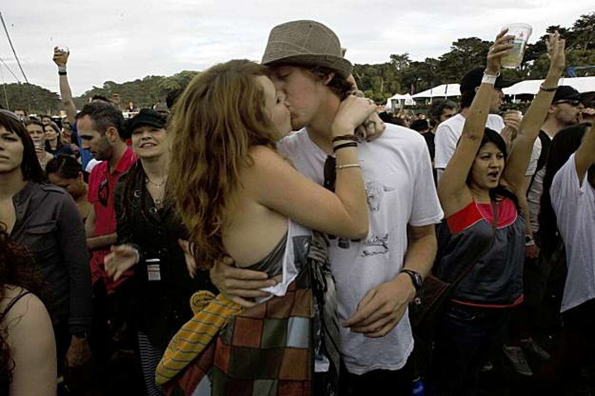Jordan Martin and Linz Jordeth from Santa Cruz, kiss during Incubus at the Outside Lands music festival in San Francisco, Calif., on Friday, August 28, 2009.