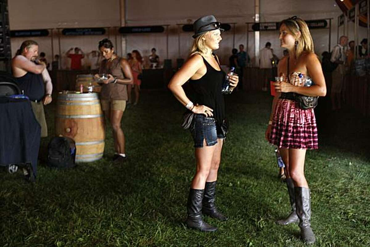 Kristen Grose (left), from Phoenix, and having Pinot Noir from Zepaltas, and Angela Roth (right) having Gewurztraminer from Banyan at Winehaven--winetasting room at the Outside Lands music and art festival in San Francisco, CA, on Friday, August 28, 2009.