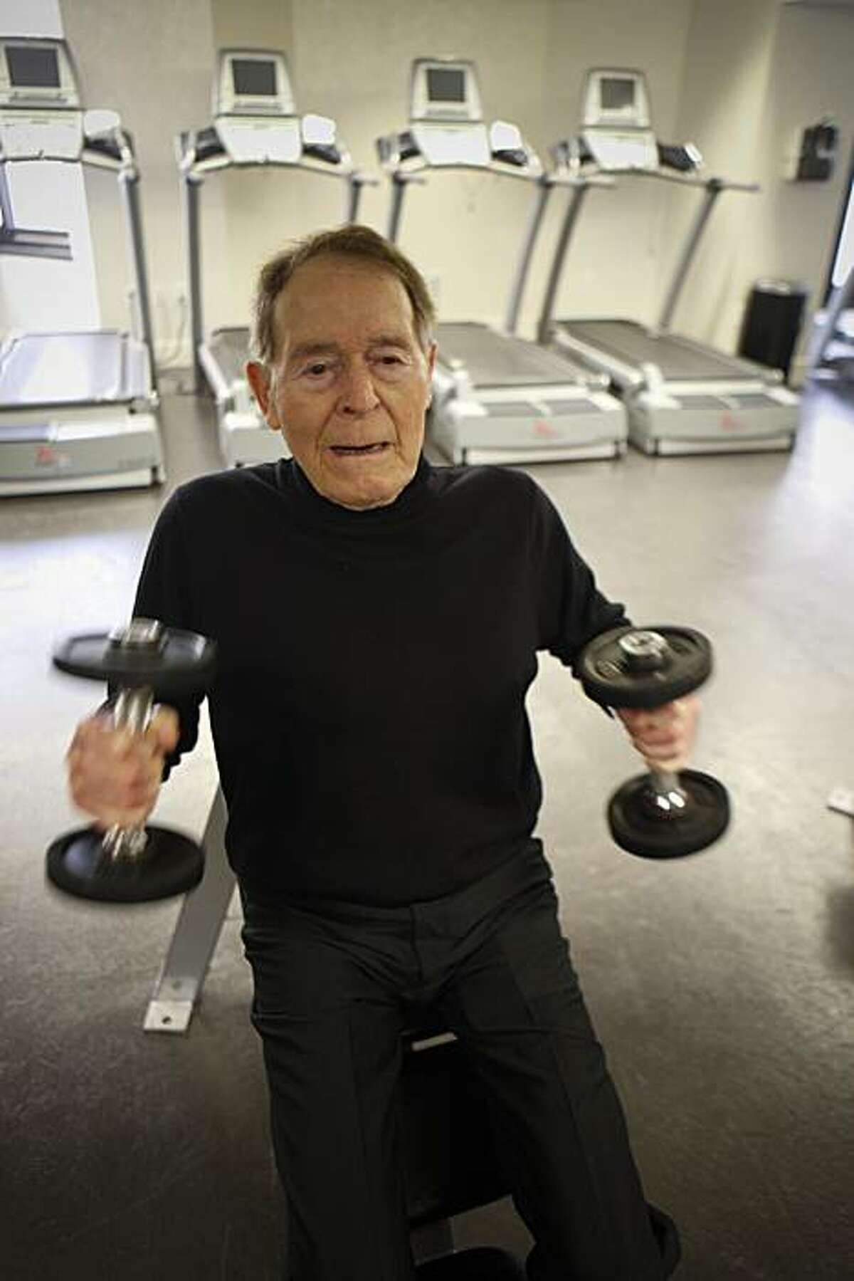 Fitness pioneer Jack LaLanne takes reporter Carolyn Zinko through a mini-workout at the Parc 55 Hotel in San Francisco in 2009.